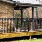 Black Flattop Railing with Circles around Porch